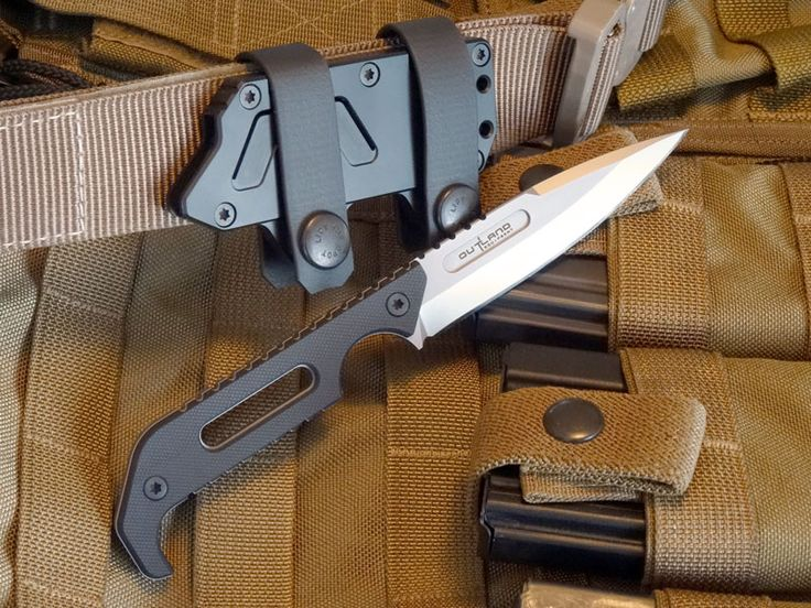 "Outland's Kryptos knife was developed in cooperation with America's Special Operations Forces for optimum concealed carry, swift and natural draw, and reliable retention. The handle shape, sheath profile and strap system have been designed for discreet horizontal carry on 1.5"" tactical belts. The sheath is ambidextrous for right or left-handed draw and can"