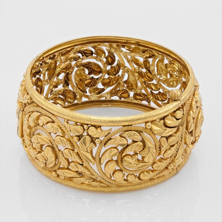 Traditional gold bangle with pear-shaped designs.