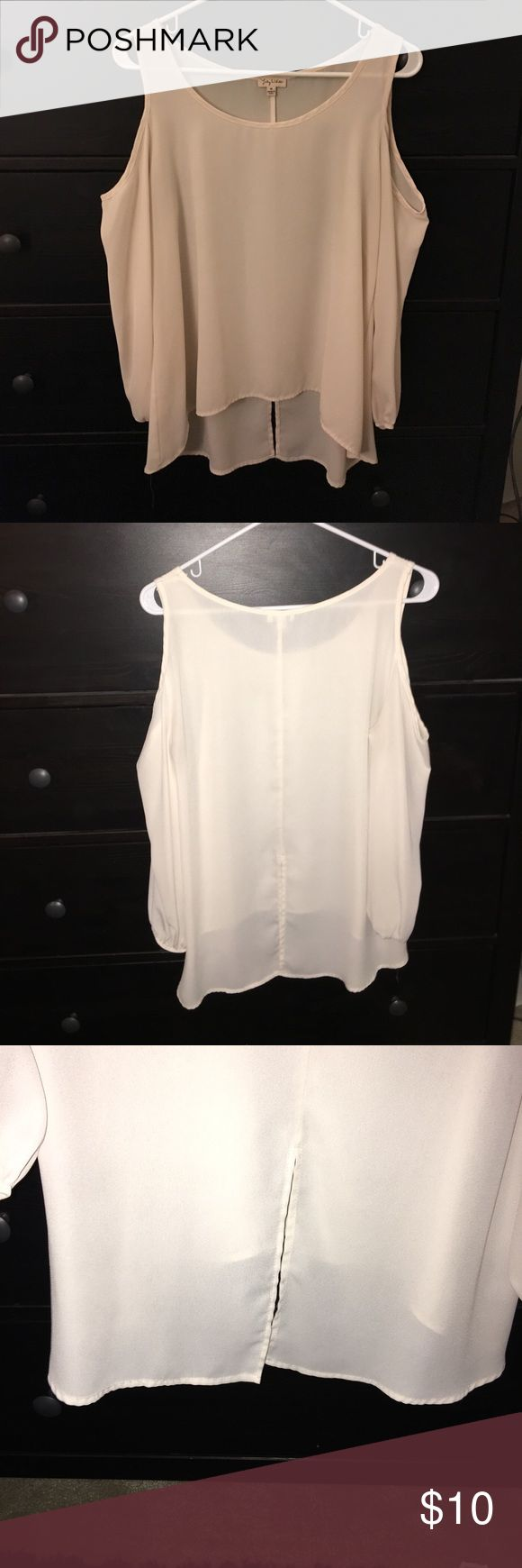 Cream long sleeve Silk cream long sleeve top. Cuts off on shoulders and has a slit in the back. Tops Blouses