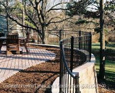 Stone Retaining Wall With Iron Fence And Brick Patio Area: Poynter  Landscape Architecture