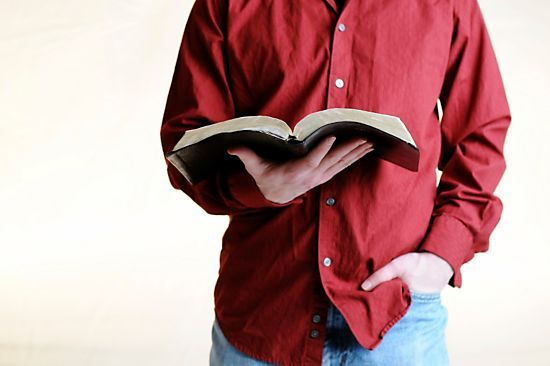 Pastor Appreciation, Pastor Appreciation Month, Pastor Appreciation Day, Man in red buttoned-down shirt holding Bible