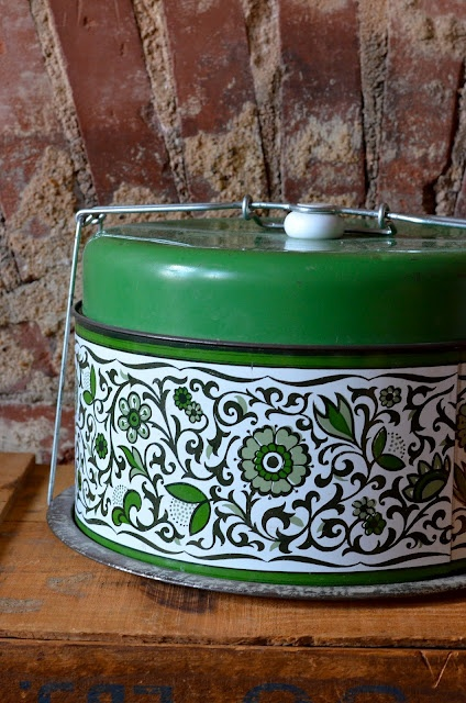 A gorgeous cake carrier that has a spot for a pie in the upper chamber.