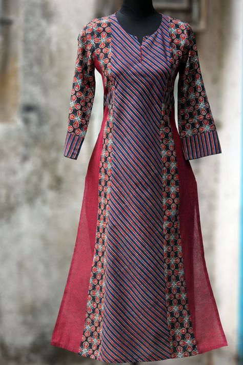 a long kurta with ajrakh in ruby colours & mangalgiri in side kalis, makes it a perfect work wear! this kurta has traditional hand embroidery