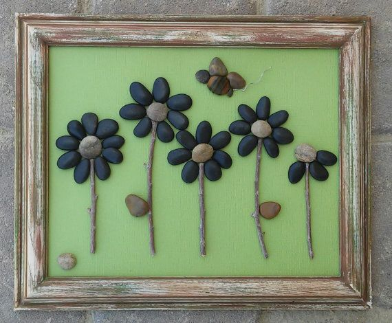 "Pebble Art (Five beautiful black flowers with flying Bee overhead) set on a pretty green background in ""open"" 8 1/2 x 11 reclaimed frame"