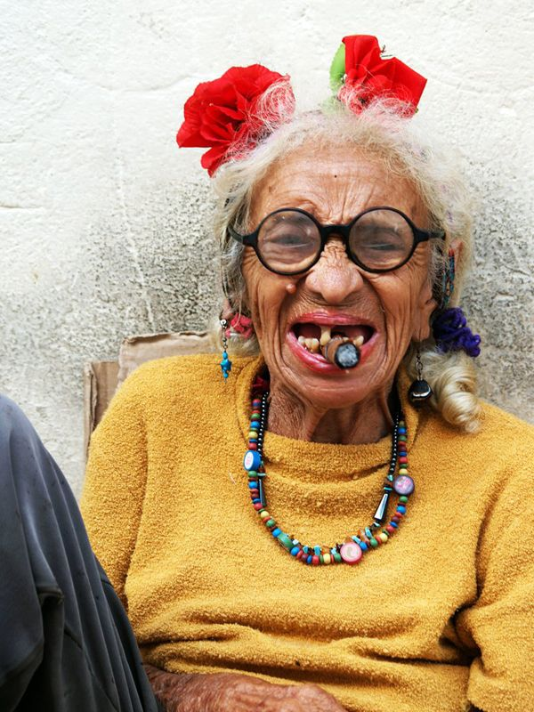 The most famous Cuban is not Fidel Castro. Nor Andy Garcia. The most famous Cuban is the old lady with a cigar. She sits next to El Bodeguita near the cathedral and makes a fortune, charging every tourist who wants her photo CUC1. And every self-respecting tourist does.