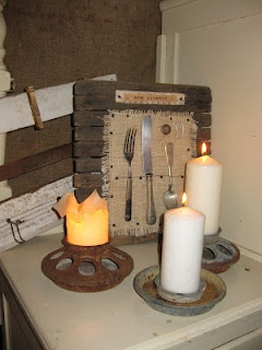 Repurposed for candle holders.  So very farmhouse chic. (from Vintage Trifles)