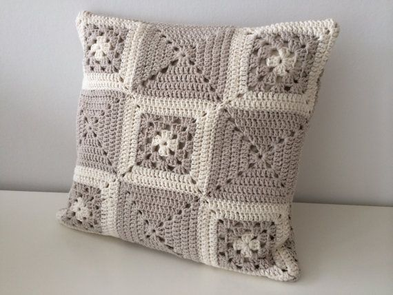 This cushion cover is crocheted in individual squares, joined together with a plain crocheted back. The back has an overlapping opening which is