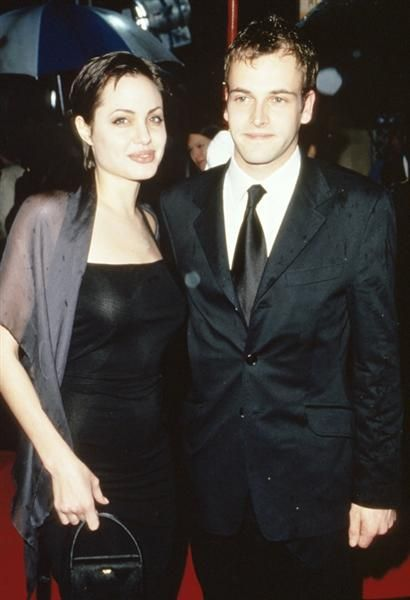 """Angelina Jolie and Johnny Lee Miller: They met on the set of the 1995 film """"Hackers"""" and married in 1996, and split just 18 months later."""