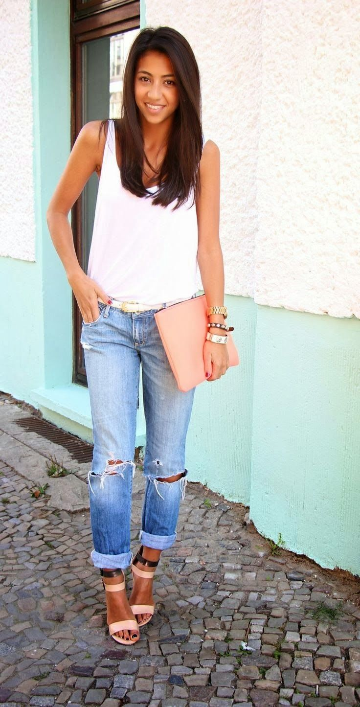 Simple look for summer with ripped denim, a minimal white tank, clutch and high heeled sandals