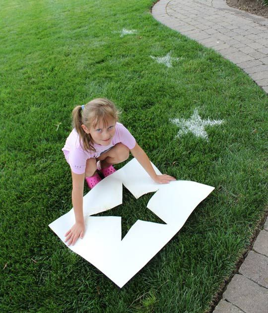 Awesome idea...make a stencil, then place it on the grass, mist area with water and sift flour over stencil!