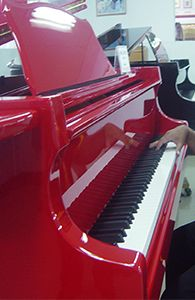 Red piano almost as cool as our turq. one..