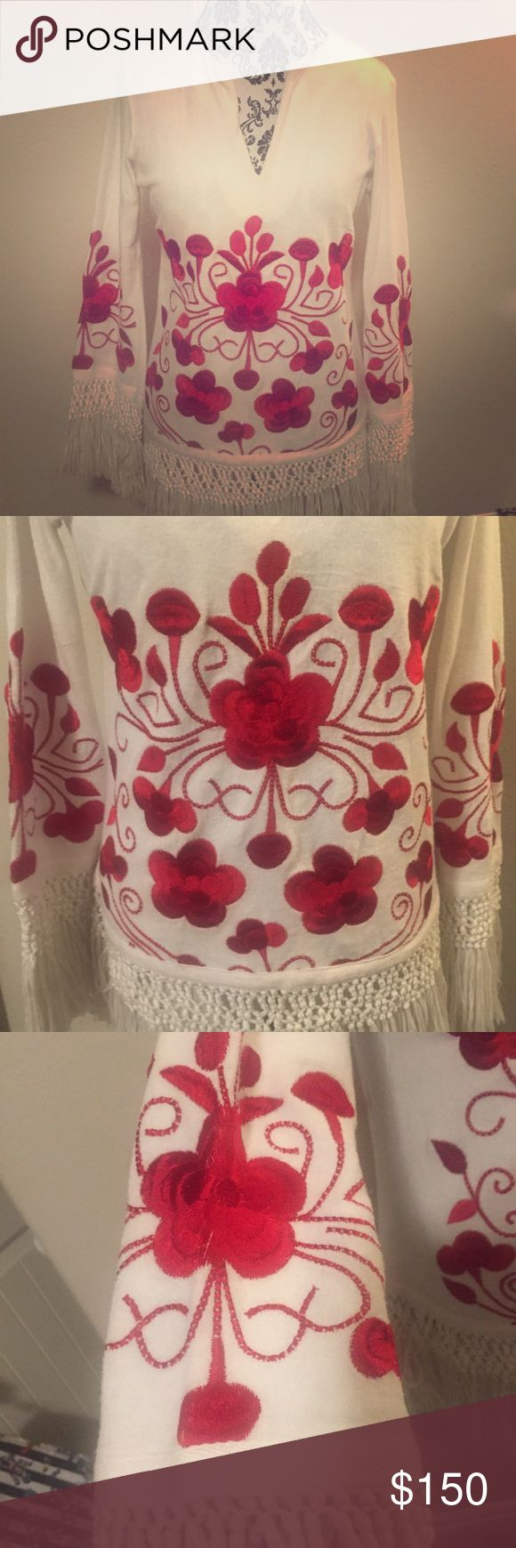 """Tory Burch Embroidered Fringed Top Beautiful 100% Cotton vneck terry cloth fringed top. Perfect as a cover up. Deep bold red embroidered floral design.  Measurements: Bust: 40"""" around  Shoulder to Hem: 23"""". To Fringe opening: 28"""" Sleeve: 19"""" to Hem. To fringe opening: 25"""" Tory Burch Tops Tunics"""