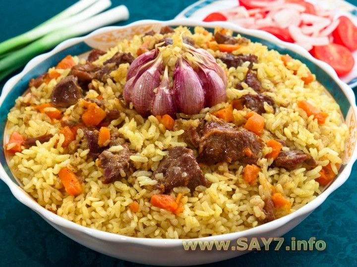 """Плов/ """"Plov"""" Ussr rice with meat and vegetables cooked in traditional way"""