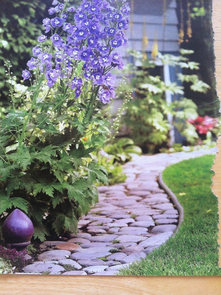 Best 20 rock garden borders ideas on pinterest rock for Grasses for flower beds