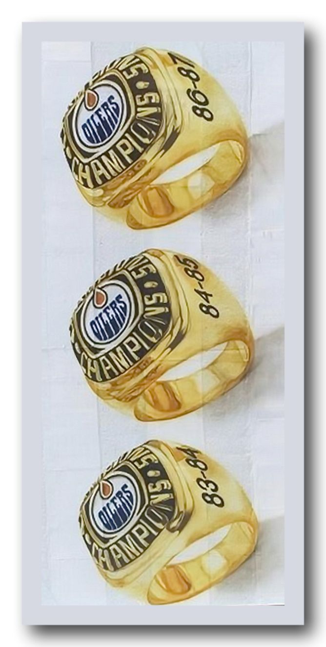 A 2000 Edmonton street mural of the Stanley Cup rings won by the Edmonton Oilers . Here are 3 of their five championship rings in a vertical view of the Edmonton mural.