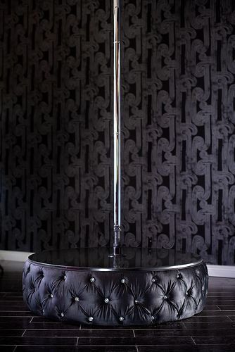 8031 TUFTED VELVET MINI STAGE WITH STRIPPER POLE - ACCENTED WITH SWAROVSKI CRYSTALS  Bring the sexiness to your house with this fabulous stripper pole. Featuring a mini stage that is upholstered in velvet and tufted with Swarovski crystals, it is a luxurious and fun addition to your home! As with many of our items, it can be customized to make it truly unique and yours alone!