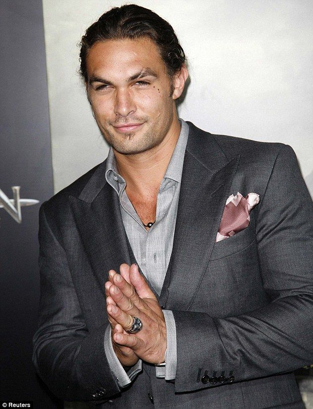 Dapper: Jason Momoa arrived at the Los Angeles premiere of Conan The Barbarian last night looking smart in a grey three-piece suit