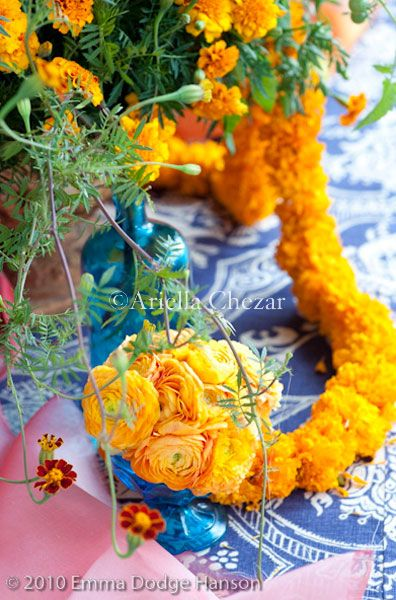 Ariella Chezar - Indian wedding with marigolds! Larger arrangements spill over into small arrangments - beautiful!