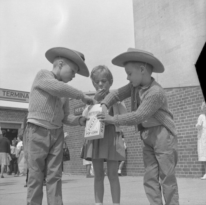 A few kids enjoying their buttered popcorn at the 1963 CNE. Who will you be sharing your CNE treats with this year?