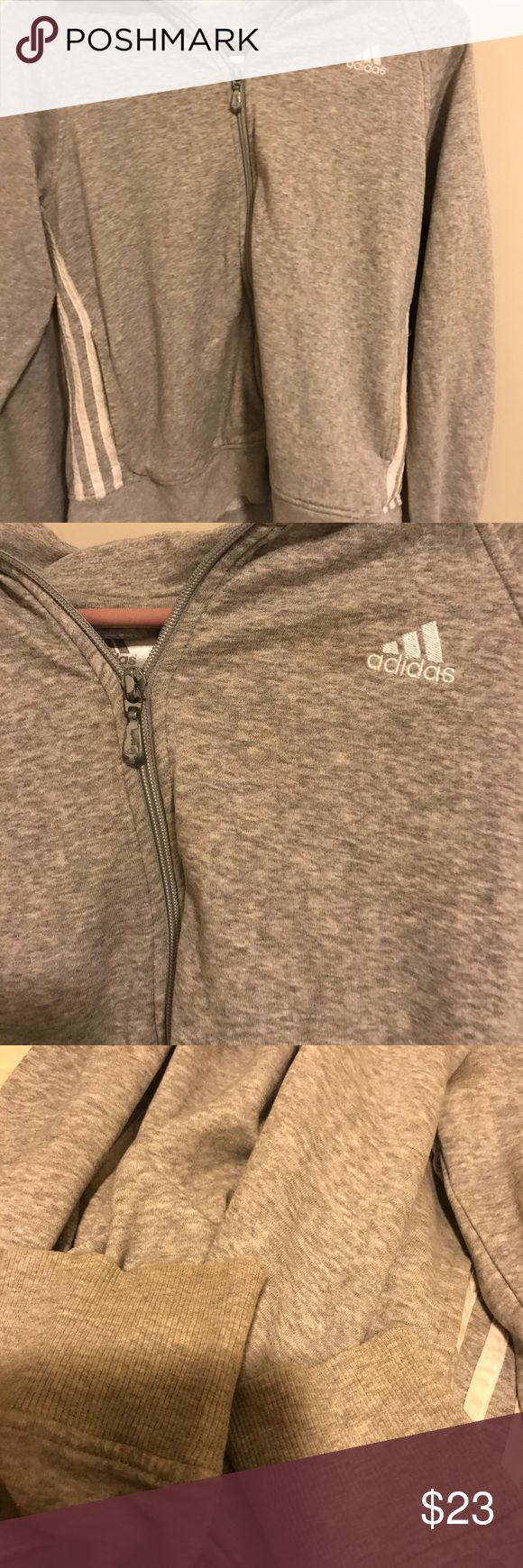 Adidas zip up Adidas zip up size medium. I'm guessing this is ladies. Sweat shirt material and zips fully. Does have some spotting and wear. Couldn't capture everything great in pictures. It's nice for lazy days. Otherwise in overall good condition. Low price reflects flaws sold as is no returns. adidas Sweaters