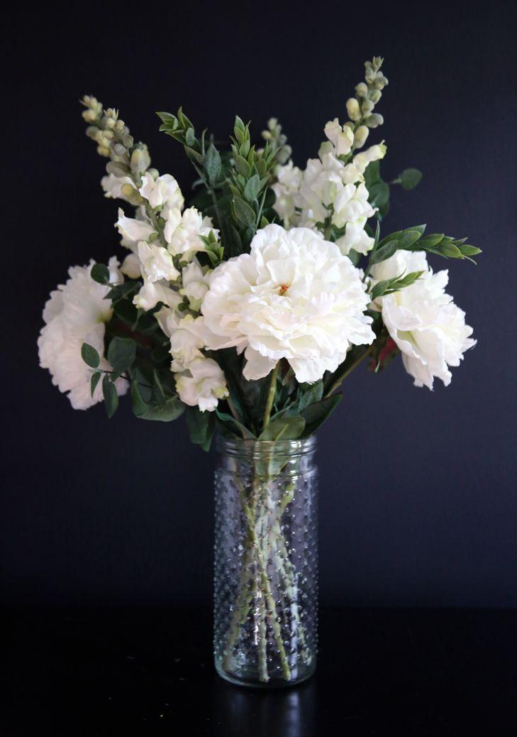 all white faux flowers arrangement