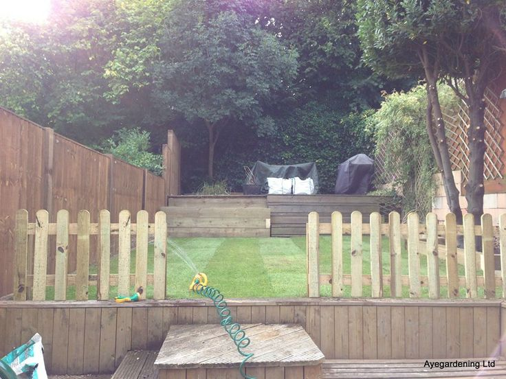 This one from Aye Gardening has used our closeboard fence panels to great effect. Plus, the sleepers and picket fence look great too.