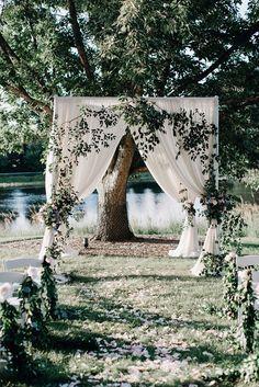 Love this outdoor ceremony decor! photo  by Codrean Photography http://ruffledblog.com/romantic-pastel-garden-wedding