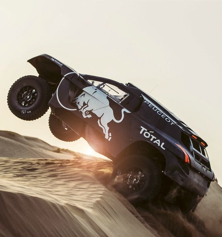 Carlos Sainz pushes the Peugeot DKR to the edge.