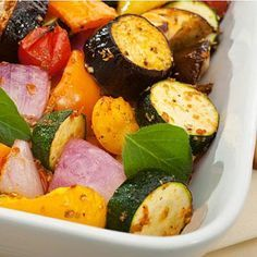 Preheat oven to 450°F. Clean and cut up an assortment of vegetables such as carrots, bell peppers, onions, zucchini, eggplant, mushrooms, Brussels sprouts, asparagus and butternut squash. Toss vegetables with olive oil, salt and pepper and place on a baking sheet. Roast vegetables in oven until tender and edges start to brown, about 45 minutes. Flip once or twice during roasting. Keep in fridge for up to 4 days or freeze for up to 3 months.