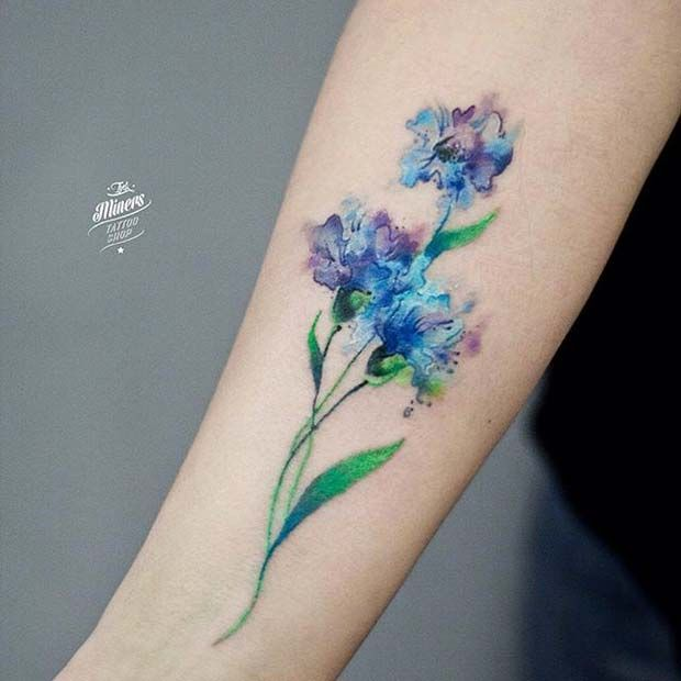 21. Watercolor Flower Tattoo Flowers are a great way to play around with watercolor effects and as you can see from this beautiful blue floral design, you can really make the colors pop! 22. Blue Feather on Back Combining a dark colour like the black you can see here with the watercolor shades of blue …