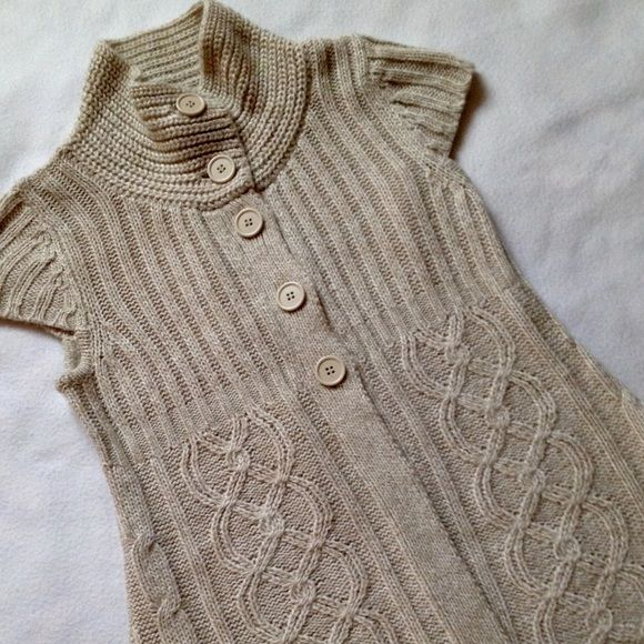 Knitted vest/ sweater / short sleeve Cute! Very soft and cozy, pair it with long sleeve tee under. It's made of polyester, tag says size M, but actually fit size XS/S. Used only once, no wear. Sweaters