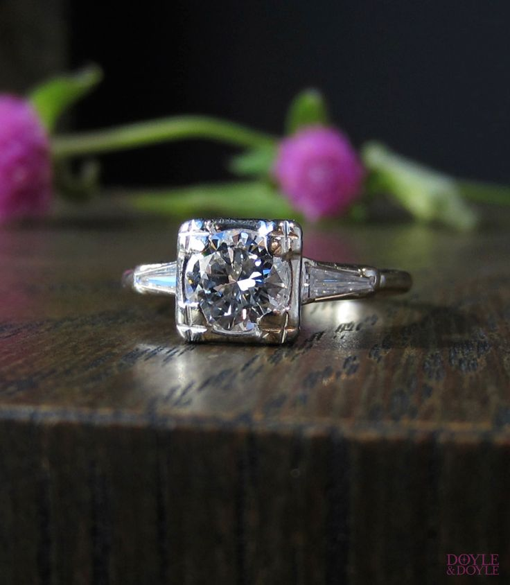 Vintage diamond engagement ring with tapered baguettes in 14k white gold. Circa 1950, from Doyle & Doyle.