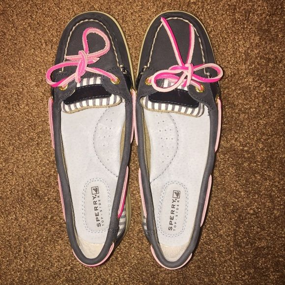 Sperry Top-Sider boat shoe Sperry Top-Sider Angelfish navy stripe boat shoe. The shoe is navy with white and blue stripes and the tie is hot pink. Great condition. Worn twice but they are too tight on me. They are a size 5 1/2.. Comes with box. No trades. Sperry Top-Sider Shoes Flats & Loafers