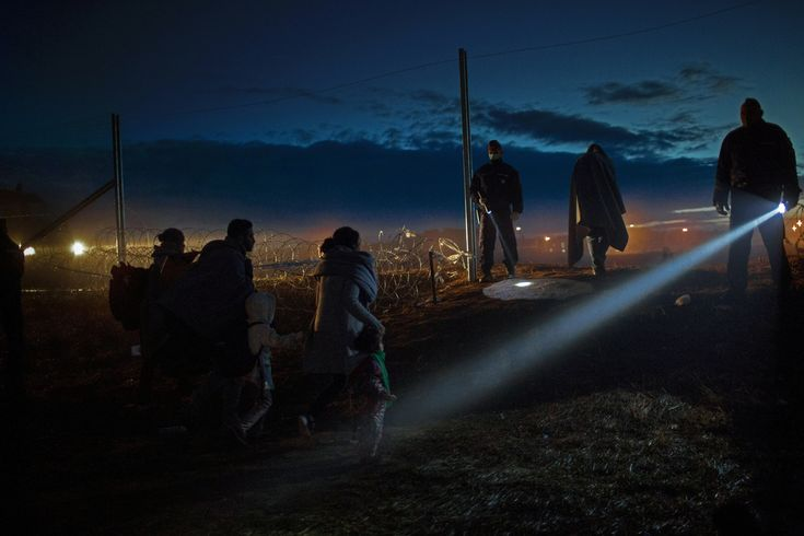 """Balkan refugees, Hungary route. Hungarian border police place their flashlight beam towards a Syrian family. They are fleeing from war to a safer place in Europe, approaching the continent through Croatia to Hungary on their """"Balkan route."""" Before Hungary closed its border, refugees were coming day and night, by... more»"""