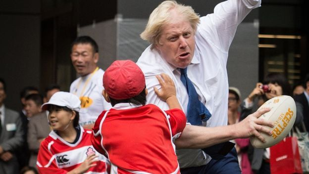 Boris Johnson knocks over kid playing rugby