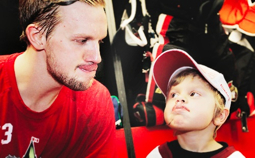 Alex Edler with Fenix Alfredsson (Daniel Alfredsson's son) at the 2012 All Star game
