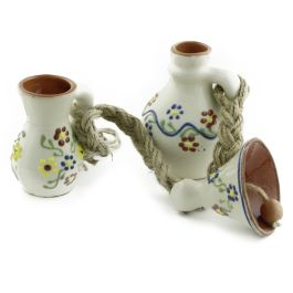 Handmade from Baia Mare glazed ceramic, this three miniature decorative set brings to our days the tradition of the well-made things, infused with love and passion for the craft.The three miniature pieces are attached to a twined rope for hanging and they represent traditional objects specific to Romanian households (jug, cup and bell).