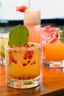 Atlantic Sun Recipe  Ingredients  Vodka, 2 oz  Peach liqueur, 2 oz  Passion fruit syrup, 2 oz  Sweet and sour mix, 6 oz  Club soda