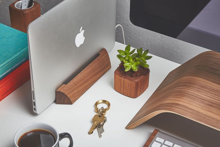Walnut wooden macbook dock with the Grovemade desk collection: planter, monitor stand, key ring & keyboard tray.
