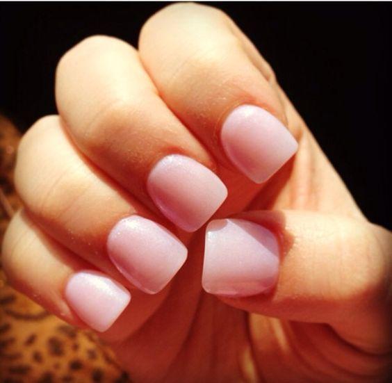 Short baby pink acrylic nails:
