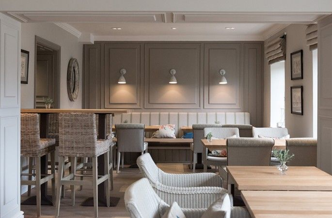 this is from a restaurant but really like the color of the wall, sconces, and banquette - peaceful and spa-like