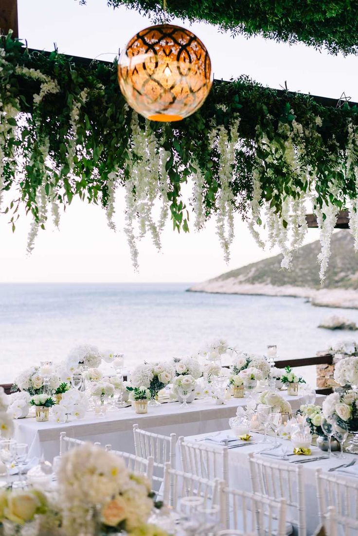 wedding reception ideas,  table decoration for your wedding  - photo by Elias Kordelakos https://ruffledblog.com/destination-wedding-weekend-in-sifnos-greece
