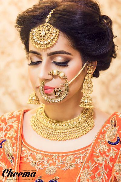 Wedding Nose Rings - Intricate Gold Nose Ring with Gold Jewelry | WedMeGood  #wedmegood #indianwedding #indianbride #nosering #nath #gold #orange #jewelry #indianjewelry
