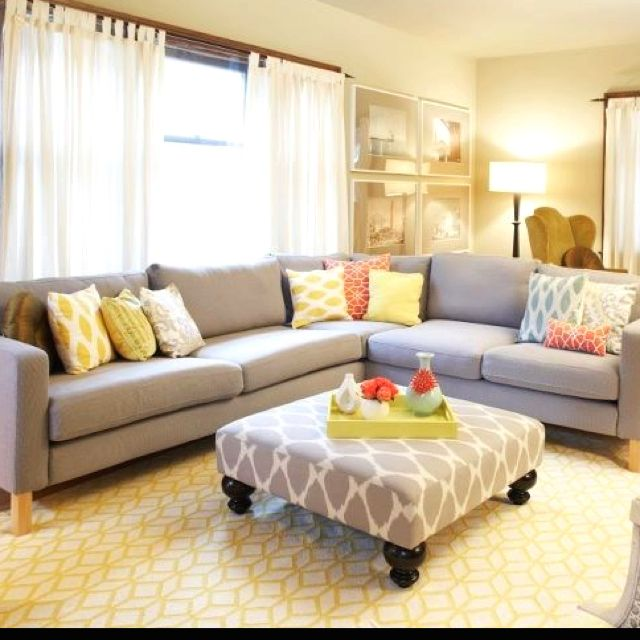 Light and bright living room.  Neutral furniture, pops of color, bold print on the ottoman: Grey Couch, Coffee Tables, Gray Couch, Bold Prints, Colors Schemes, Rooms Ideas, Families Rooms, Studios Couch, Bright Living Rooms