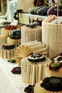 """old book display spindles... could spray paint some of them to match tablecloth and leave others """"natural"""""""