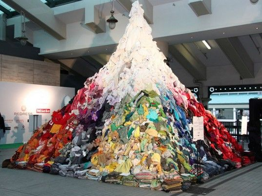 "16-Foot Clothing Mountain Illustrates Hong Kong's Daily Textile Waste. The equivalent of 7.5 tons of textiles, the ""3% Mountain"" is only a tiny percentage of the 253 tons of clothing Hong Kong residents throw away on average each day."