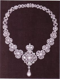 Queen Victoria's Golden Jubilee Necklace - it was presented to her on 6/24/1887. The design is of graduated diamond trefoils, each with a pearl centre. The centre piece is a quatrefoil of diamonds with a a pearl centre & drop pendant. Surmounting it is a pearl & diamond crown. It is possible to detach the centre piece & wear it as a pendant. Queen Victoria left the necklace to the Crown in 1901.