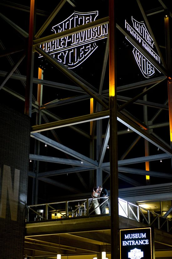 This patio overlooks the Harley-Davidson Museum's campus and is surrounded by cool Harley-Davidson signage. Photo by JBe Photography. Click to see more Milwaukee wedding photo spots at the Harley Davidson Museum.