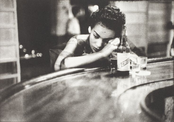 FAMAG 2008.26.7 | Arnold, Eve (1912-2012): Cuban Bar Girl, Havana, 1954, printer: Stoneman, Hugh (1947-2005), publisher: Hugh & Linda Stoneman with Michael Ward, signed and dated 2002, photogravure etching (artist's proof) published 2002, 25 x 35.5 cms. The Art Fund Hugh Stoneman Archive. © Eve Arnold & Magnum Photos. | The Permanent Collection | Falmouth Art Gallery