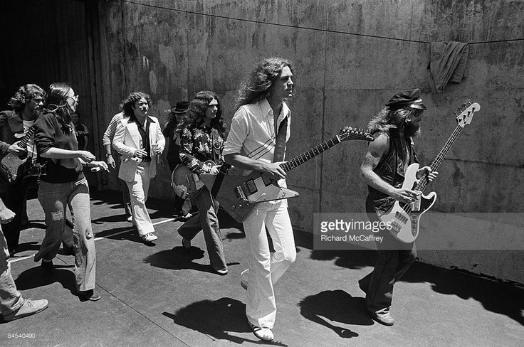 "Lynyrd Skynyrd ( L-R Steve Gaines, Billy Powell, Ronnie Van Zandt, Gary Rossington, Allen Collins and Leon Wilkeson) approach the stage at the Oakland Coliseum in 1976 in Oakland, California ""How To"" Producers Guide to DIY Home Music and Music Studio  Projects 